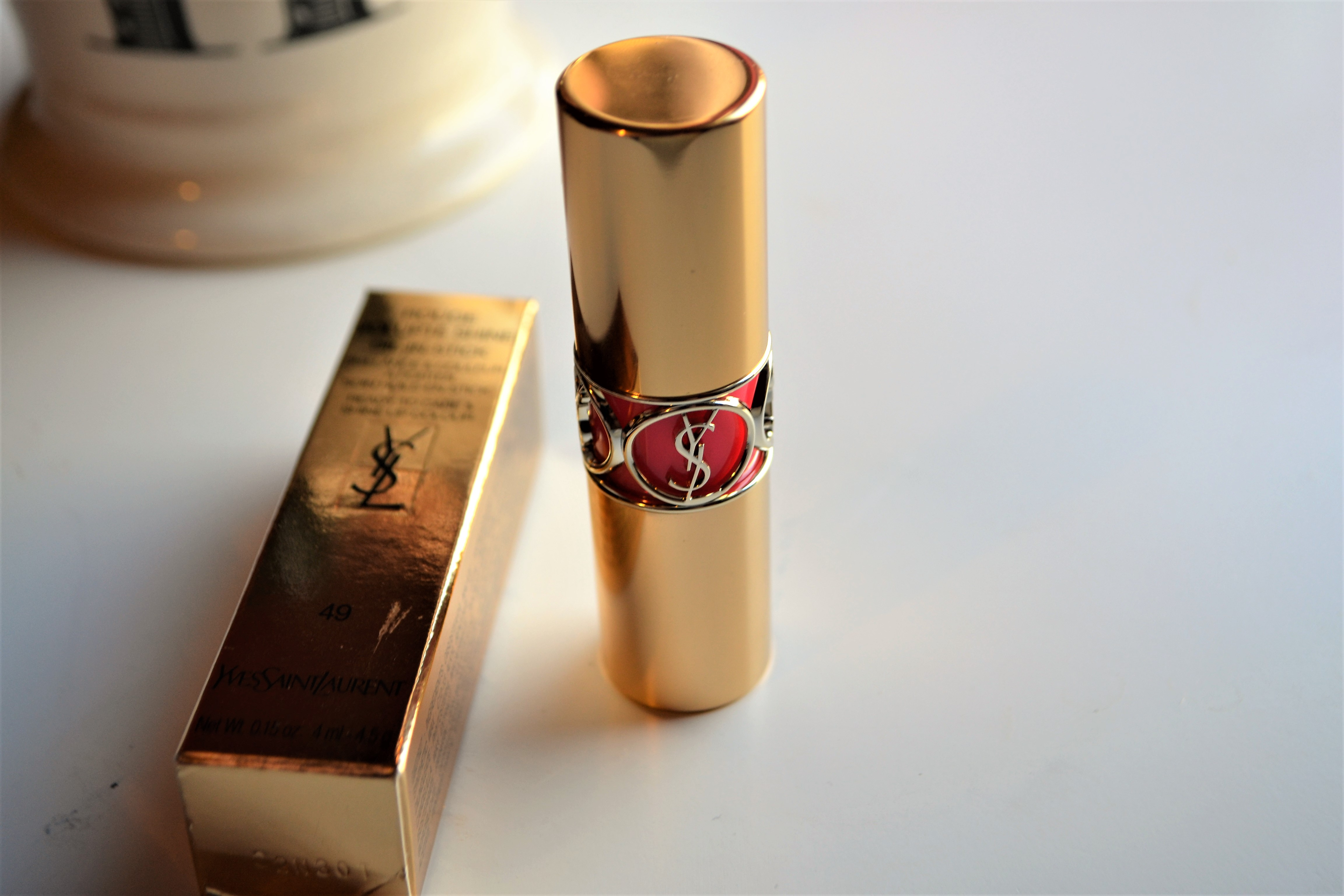 9af23caef3b Gold (almost rose gold in some light) metal surrounds the lipstick that  gives it a high-quality feeling and protection. The silver YSL detail is in  the ...